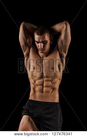 Sexy Athletic Man showing six pack abs.