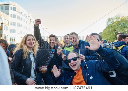 AMSTERDAM, NETHERLANDS  on APRIL 26, 2015. City natives and tourists group portrait during celebration Queen's Day or King's day, Dutch annual national holiday, in the streets Amsterdam, Holland