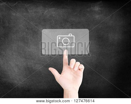 Finger tapping on an icon to symbolize digital photography