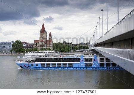 Vienna, Austria - May 7: Cruise Ship On Danube With St. Francis Of Assisi Church On Mexikoplatz On 7