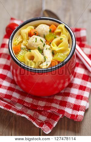 Red cup with chicken meatball tortellini soup ** Note: Soft Focus at 100%, best at smaller sizes