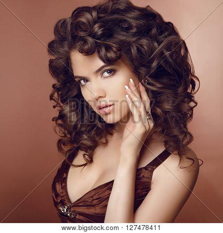 Healthy Hair. Beautiful Young Smiling Woman With Long Curly Hairs. Brunette Girl Model With Professi