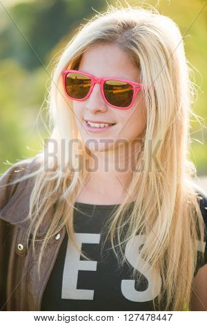 Close up outdoor portrait. Blonde woman posing outdoor.