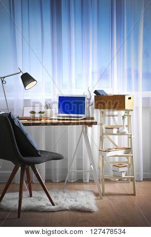 Modern workplace on light background