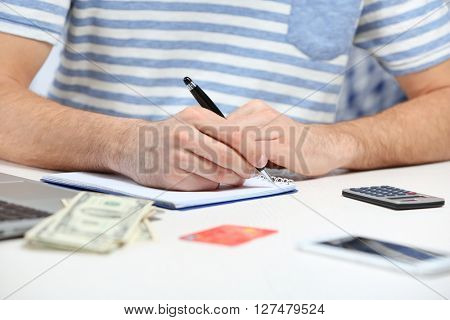Man counting money and making calculations