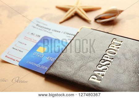 Credit cards with passport and tickets for vacations on the world map background