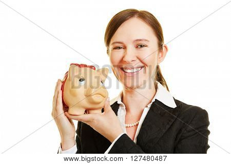 Smiling business woman with a piggy bank in her hands