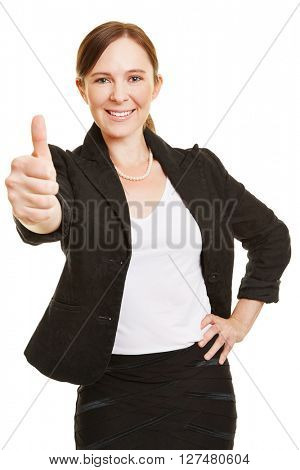 Happy businesswoman smiling and holding her thumbs up