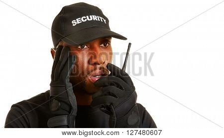 Man as security guard giving alarm with his radio set