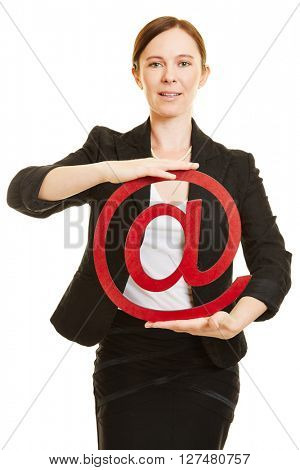 Business woman holding big red at sign as email symbol