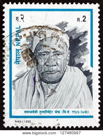 NEPAL - CIRCA 1998: a stamp printed in the Nepal shows Tulsi Meher Shrestha Social Worker circa 1998