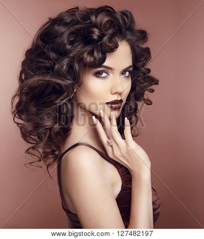 Curly Hairstyle. Beauty Makeup. Fashion Brunette Woman With Sexy Lips. Manicured Nails. Jewelry. Stu