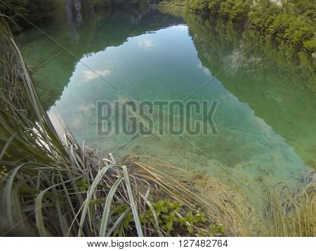 Old boat underwater in Plitvice lake, Croatia