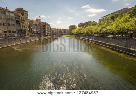 The Onyar river peaceful in Girona, Spain