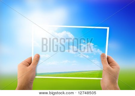 photo of green field in hands
