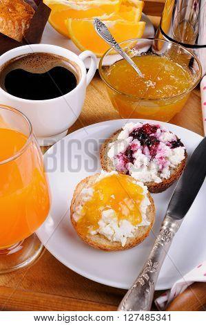 bun with ricotta orange and cherry jam for breakfast