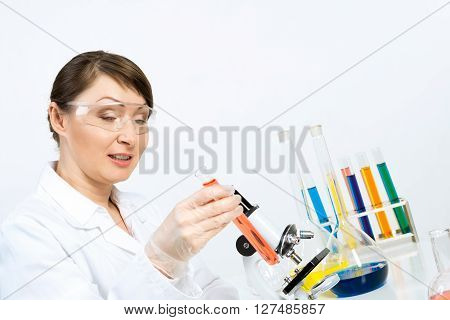 Attractive female scientist making tests in laboratory
