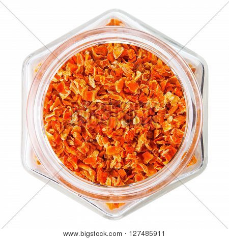 dried carrot slices in a bowl, isolated white background.