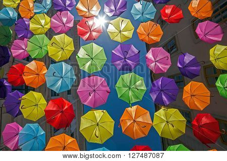 Background with colored umbrellas on one street in Timisoara Romania.