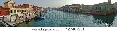 MURANO ITALY - JANUARY 25 2016: Panorama in Venice Italy Murano. Water boats canal and traditional buildings.117 islands separated by canals and bridges. Murano is glass making island.