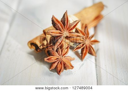 Various spices on a white wooden background.