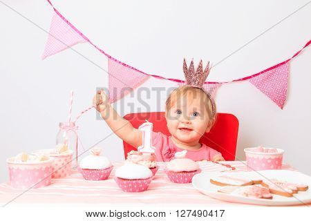 cute little princess eating sweets at first birthday party ** Note: Soft Focus at 100%, best at smaller sizes