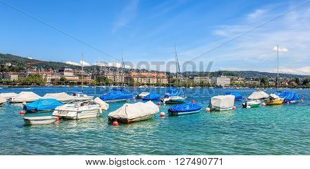 Zurich, Switzerland - 3 July, 2014: yachts and boats on Lake Zurich. Lake Zurich (German: Zuerichsee) is a lake in Switzerland extending southeast of the city of Zurich, which is the largest city in Switzerland.