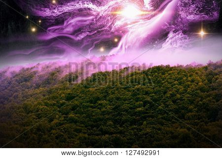 Misty mountains with night time star scape