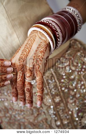 Hand with henna tattoo for a Hindu wedding
