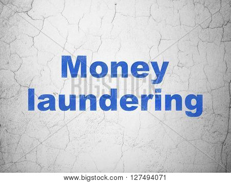 Money concept: Blue Money Laundering on textured concrete wall background