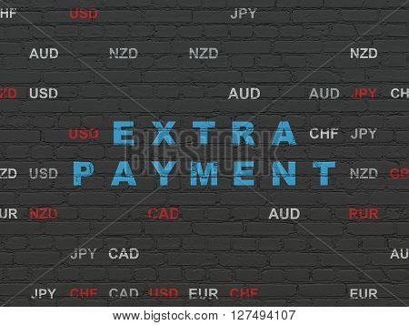 Currency concept: Painted blue text Extra Payment on Black Brick wall background with Currency