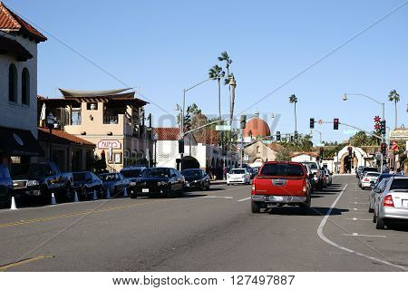 SAN JUAN CAPISTRANO, UNITED STATES - DECEMBER 25: Traffic on the main road in downtown San Juan Capistrano a tourist town with adobe houses on December 25 2015 in San Juan Capistrano.