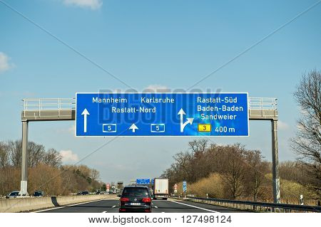 GERMANY - MAR 26 2016: Bundesautobahn or Federal Motorway highway street signs to Mannheim Karsruhe Rastatt-Nord Baden-Baden and Sandweier
