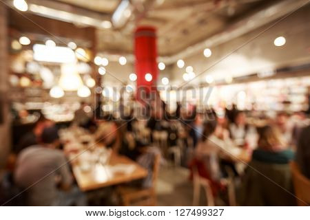 Blurred cafe or coffee shop with abstract bokeh light background.