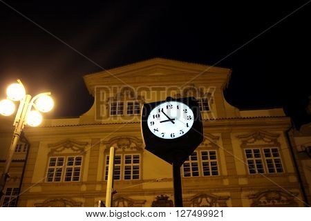 Street Clock at Night Time Against Blurry Building in Prague Czech Republic ** Note: Soft Focus at 100%, best at smaller sizes