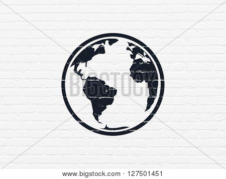 Studying concept: Painted black Globe icon on White Brick wall background