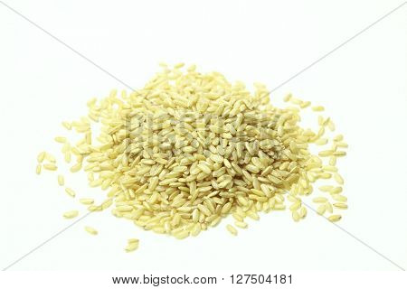 Raw beige stack of rice on white background.