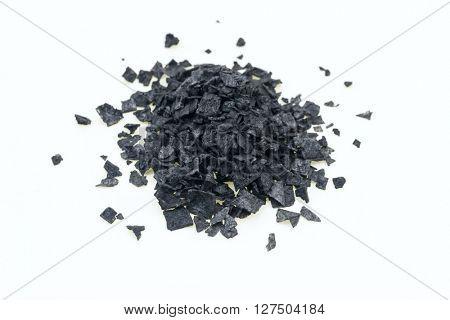 Black salt on white background