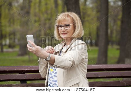 Mature beautiful woman photographed themselves on the phone