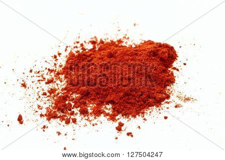 Red pepper seasoning on white background.Isolated.
