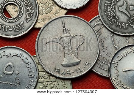 Coins of the United Arab Emirates. Arab tea pot depicted in the UAE one dirham coin.