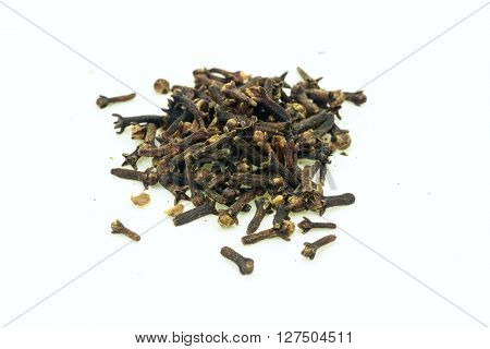 Dry cloves in pile on white background.Isolated