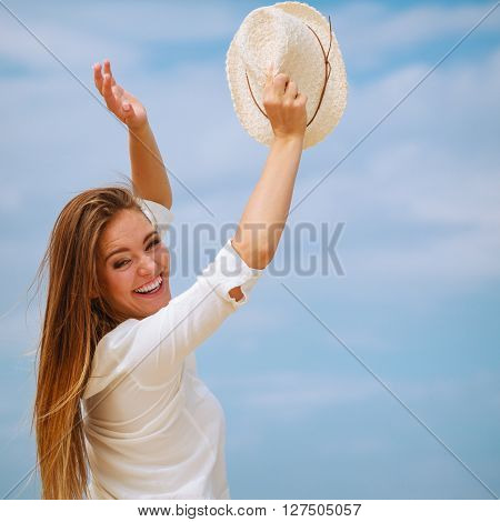 Happiness and craziness. Smiling crazy girl have fun outdoor. Young attractive long haired woman playing on summer beach.