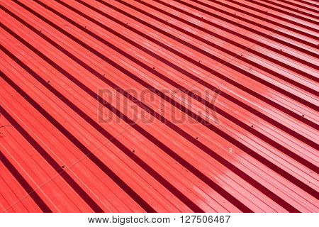 Red metal sheet for industrial building and construction.