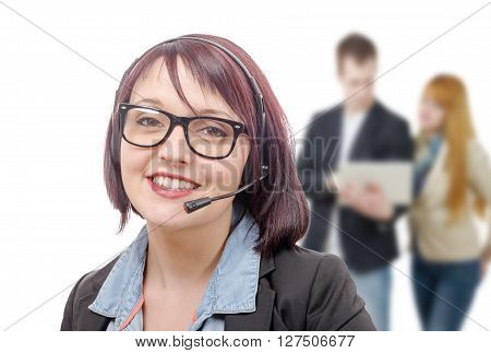 a close-up portrait of smiling young woman with headset