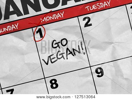 Concept image of a Calendar with the text: Go Vegan