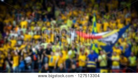 Blurred background of crowd of people - supporters in court at a sports event