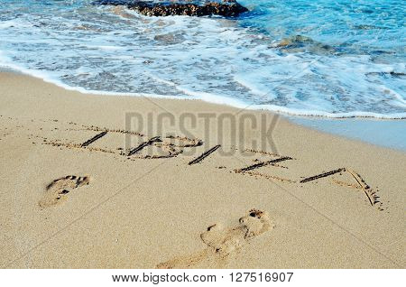 the word Ibiza written in the sand of a beach in Ibiza Island, Balearic Islands, Spain
