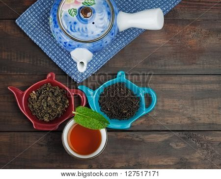 Whole Leaf Tea With Teapot And Cup On Wooden Table