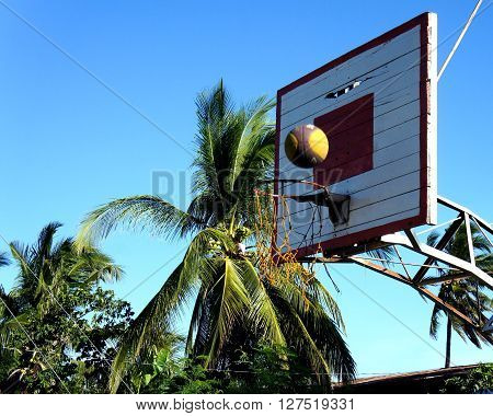 Outdoor basketball court . The ball falls into the basket.